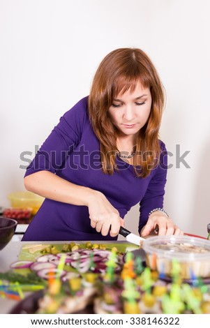 Young pretty woman housewife cooking - stock photo
