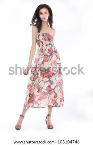 Young pretty woman in elegant light fashion dress, studio shot, series of photos - stock photo