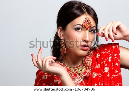 young pretty woman in indian red sari - stock photo