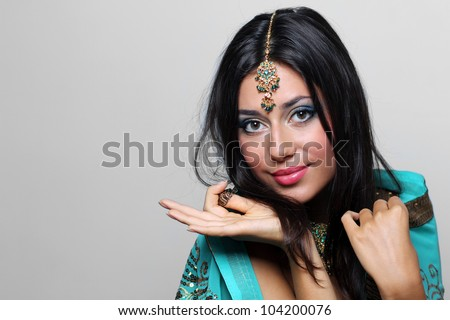 young pretty woman in indian turquoise sari - stock photo