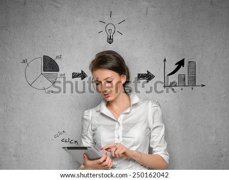 Young pretty woman in office cloth on concrete wall background with business sketches - stock photo
