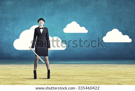 Young pretty woman in suit and hat with baseball bat - stock photo
