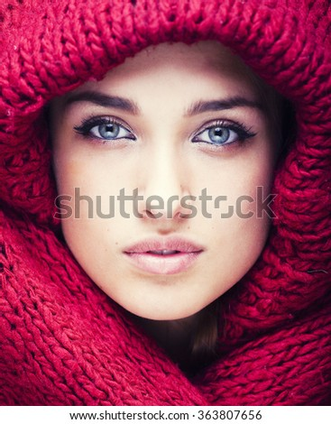 young pretty woman in sweater and scarf all over her face, soft lips - stock photo