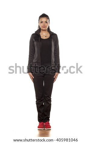 young pretty woman in tracksuits posing in the studio - stock photo