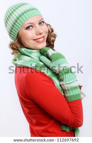 Young pretty woman in warm winter hat and scarf - stock photo