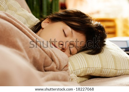 young pretty woman is sleeping at home - stock photo
