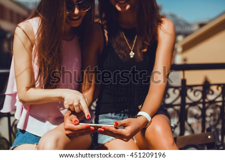 young pretty woman make selfie, girl together posing in the street, outdoor portrait, work in internet, cell cellular, facebook and instagram, touch screen  - stock photo