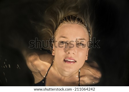 Young pretty woman on water - stock photo