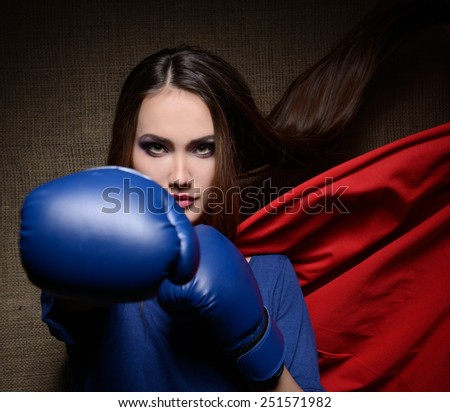 Young pretty woman opening her t-shirt like a superhero. Super girl, image toned. Beauty saves the world. - stock photo