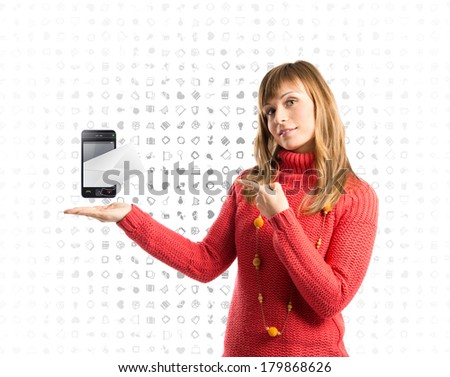 Young pretty woman pointing a phone over icon background