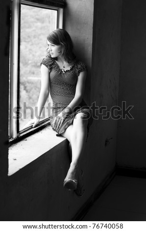 young pretty woman portrait in black and white