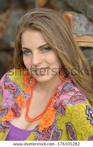 young pretty woman portrait outdoor - stock photo