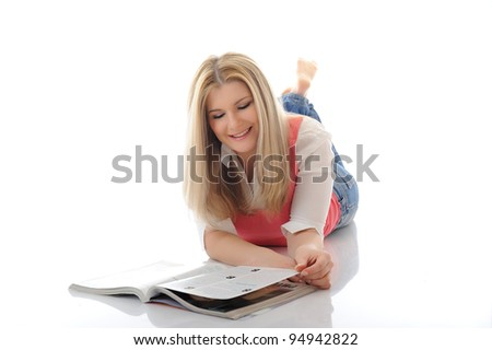 young pretty woman reading magazine. isolated on white - stock photo