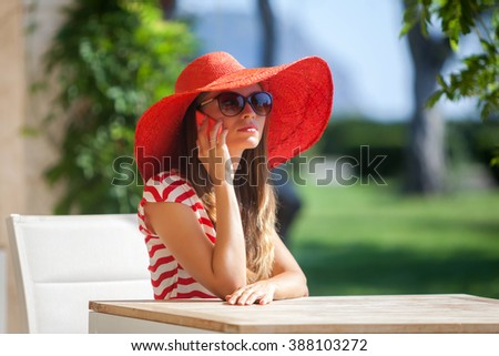 Young pretty woman sitting in a cafe - stock photo