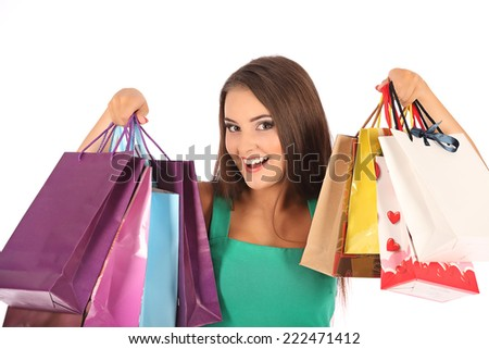 young pretty woman standing with colorfull shopping bags, studio - stock photo