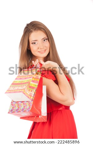 young pretty woman standing with colourful shopping bags, studio
