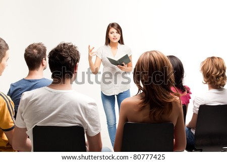 young pretty woman teaching a course - stock photo