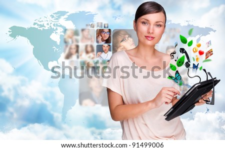 Young pretty woman using her universal device - stock photo