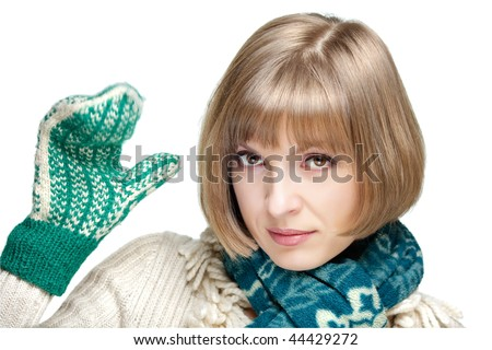 Young pretty woman waving her hand in mitten, isolated on white - stock photo