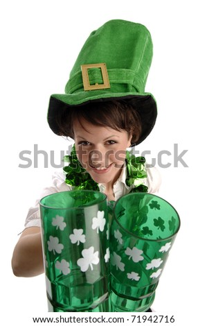 Young pretty woman wearing green hat celebrates St Patrick's day. - stock photo