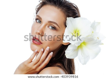 young pretty woman with  Amarilis flower close up isolated on white - stock photo