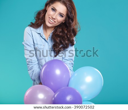 Young pretty woman with colored balloons - stock photo