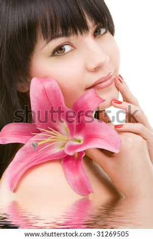 Young pretty woman with lily flower