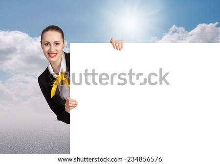 Young pretty woman with white blank banner - stock photo