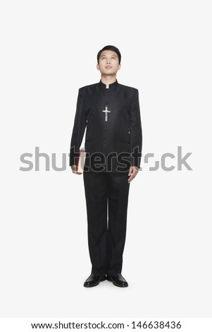 Young Priest Looking at Sky - stock photo