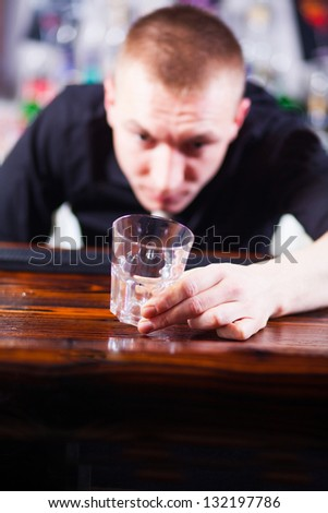 Young  professional barman in action making cocktail drinks - stock photo