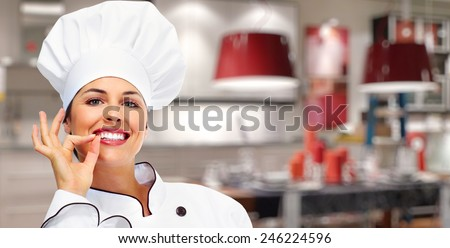 Young professional chef woman in modern kitchen - stock photo