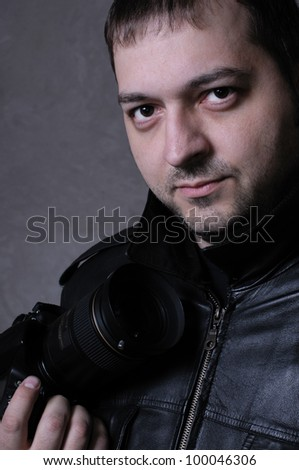 Young professional photographer - stock photo