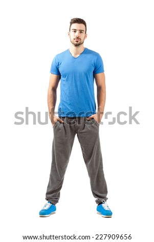 Young proud confident fit male in sportswear. Full body length portrait isolated over white background. - stock photo