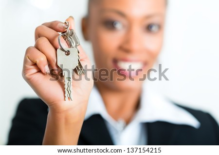 Young realtor with keys in an apartment, it could be the tenant too