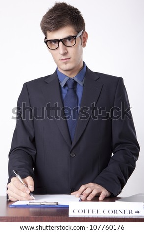 Young receptionist showing direction to coffee corner. - stock photo