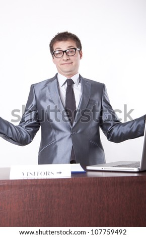 Young receptionist showing direction to visitors. - stock photo