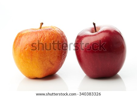 Young red and old yellow apples on white - stock photo