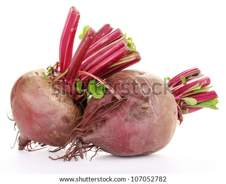 Young red beets isolated on white - stock photo
