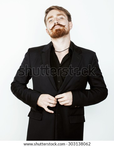 young red hair man with beard and mustache in black suit on white background close up