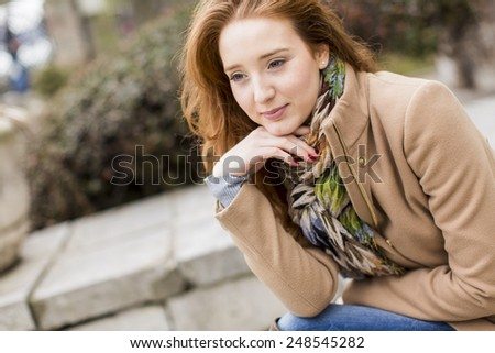 Young red hair woman at outdoors