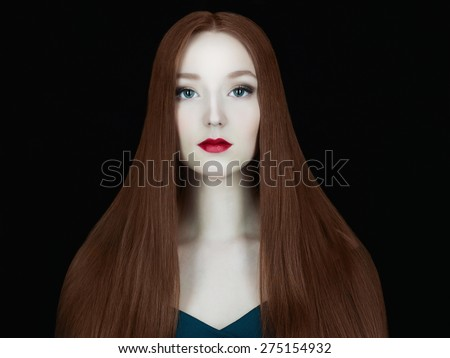 Young red hair woman.Beautiful girl model with make-up.Long healthy red hair - stock photo