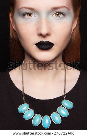 Young red hair woman with black lips.Beautiful girl model with make-up.Unusual freak - stock photo