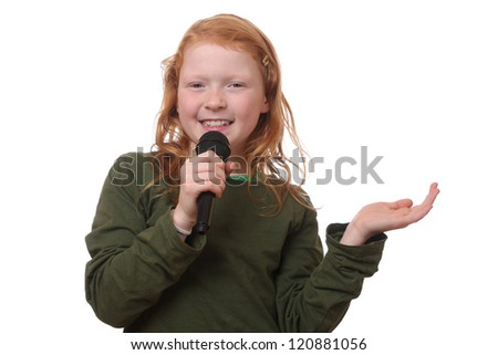 Young red haired girl with microphone on white background - stock photo