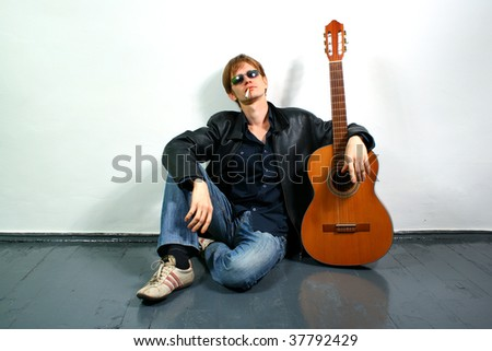 young red-haired guy with a guitar
