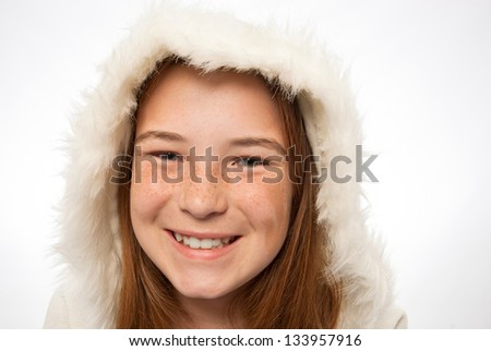 Young red headed child in a fur coat - stock photo