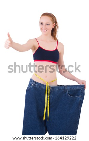 Young redhead girl in dieting concept - stock photo
