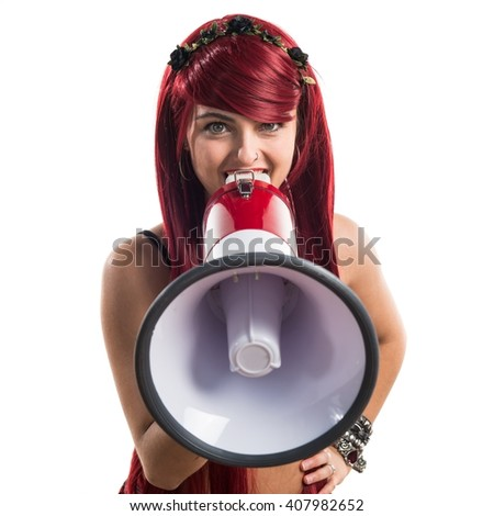 Young redhead girl shouting by megaphone