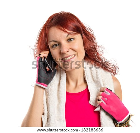 Young redhead girl talking on mobile over white background