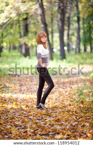 young redhead teenager woman in the forest