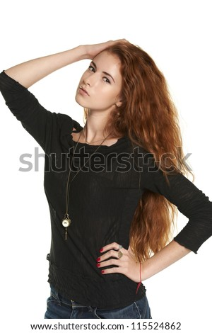 Young redheaded female posing with hand on head, over white - stock photo